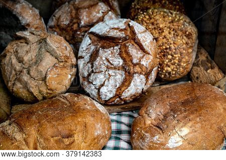A Close Up Of Different Types Of Whole Flour Homemade Bread Loaves