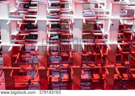 Red And White Steel Reinforcement For Reinforced Concrete.texture Of A Steel Reinforcing Bar On A Co