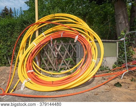 Coils Of Plastic Casings, Data Cable Put In Underground Trench. Fiber Optic Cable For Fast Internet.
