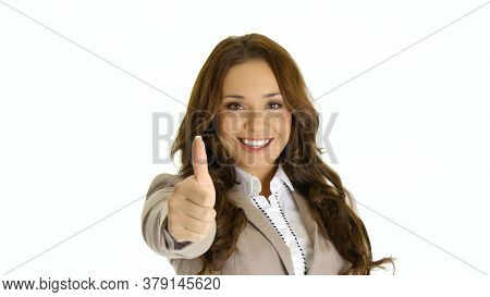 Happy businesswoman giving thumbs up. Isolated on white background