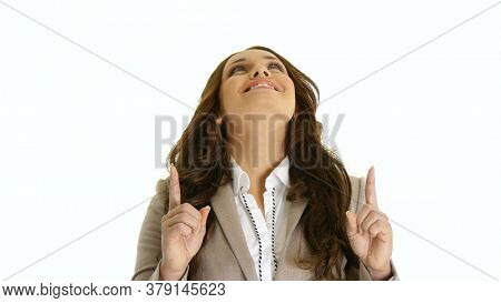 Young business woman presenting sth above her by a hand. On white background.