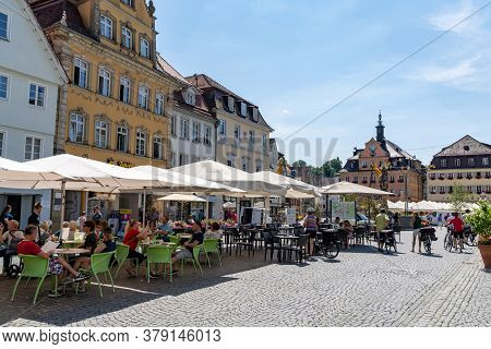 People Enjoying A Summer Day In The Street Restaurants On Market Square In Schwaebisch Gmuend