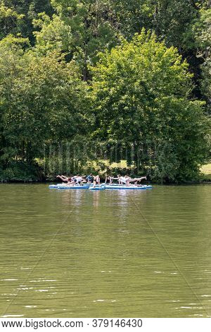 Stuttgart, Bw / Germany - 21 July 2020: Female Paddleboard Yoga Class On The Neckar River In Stuttga