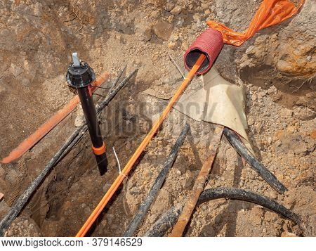 Safety Tube With  Optic Fiber Cables. Bulding Site With Trench For Underground Telephone Optical Lin