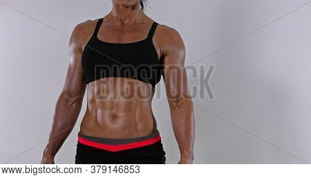 Muscular abdomen of fitness woman. Bodybuilding concept.