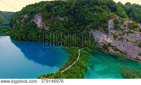 Blue and turquoise ponds and waterfalls in Plitvice Lakes National Park.