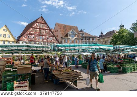 People Enjoy Buying Food At The Weekly Farmers Market In The Town Square Of Esslingen On The Neckar