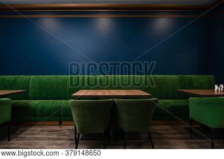 Empty Dark Wooden Table In Front Of Restaurant. Empty Table Dark Restaurant Copy Space On The Wall C