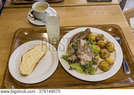 Hearty Lunch. A Plate With Young Potatoes And Meat Is Standing On A Tray With Coffee And Juice. Morn