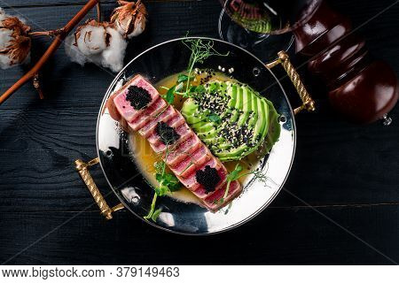 Mexican Tuna Steak With Avocado Closeup On A Plate. Red Steak Tuna Grilled Bbq With Avocado Top View
