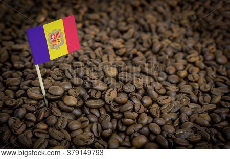 Andorra Flag Sticking In Roasted Coffee Beans. The Concept Of Export And Import Of Coffee
