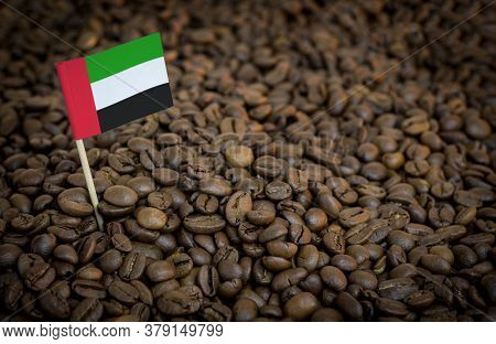 United Arab Emirates Flag Sticking In Roasted Coffee Beans. The Concept Of Export And Import Of Coff