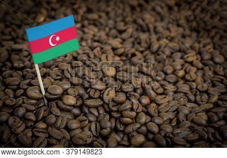 Azerbaijan Flag Sticking In Roasted Coffee Beans. The Concept Of Export And Import Of Coffee