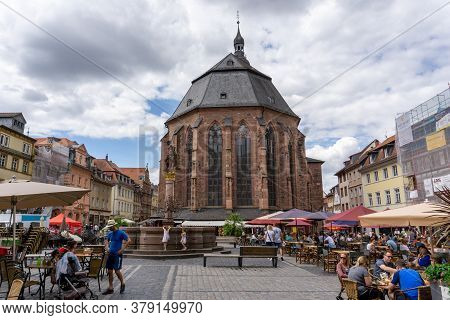 Many Tourists Enjoy A Day In Historic Heidelberg In The Cafes On The Market Square
