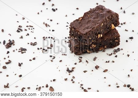 Brownie Pieces On White Background. Delicious Chocolate Pie.