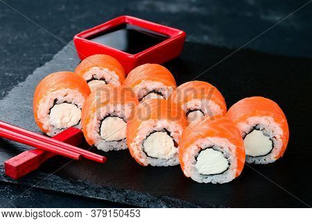Beautiful Classic Sushi Set Rolls Philadelphia Close Up With Salmon And Cream Cheese Close Up. Urama