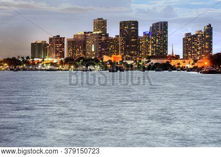 Miami Skyline At Night - Panoramic Image. Miami, Florida, Usa Skyline On Biscayne Bay, City Night Ba