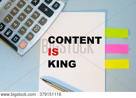 The Content Is A Content Is King On A White Ring Binder Notepad With A Hand Pencil, A Digital Busine