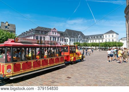 Trier, Rp / Germany - 29 July 2020: Tourist Sightseeing Train In Front Of The Cathedral In Trier In