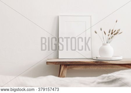 Portrait White Frame Mockup On Vintage Wooden Bench, Table. Modern White Ceramic Vase With Dry Lagur