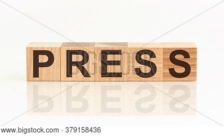 Wooden Blocks With The Text: Press. The Text Is Written In Black Letters And Is Reflected In The Mir