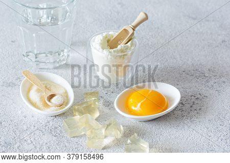 Products (collagen Powder, Gelatin, Yolk) Which Contain Collagen.diced Gelatin.collagen Powder On A