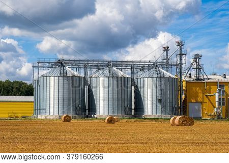 Metal Silos On Agro Manufacturing Plant For Processing Drying Cleaning And Storage Of Agricultural P