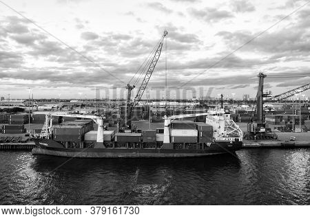 Miami, Usa - March 01, 2016: Containership In Cargo Port. Vessel With Cargo On Cloudy Sky. Container