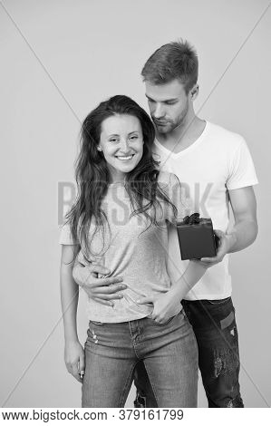 Pack Your Present In Box. Happy Couple Hold Gift Box. Wrapped Present Box With Bow. Wrapping Paper.