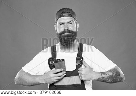 Mechanic Enjoy Coffee. Handsome Builder Hold Coffee Cup. Energy Concept. Caffeine Addiction. Brief C
