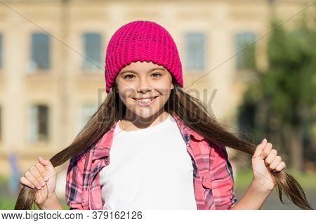 I Just Let My Hair Grow Long. Happy Girl Hold Long Hairtails Sunny Outdoors. Trendy Hairstyle. Long