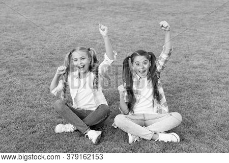 Lets Celebrate. Happy Kids Make Winner Gestures. Little Children Celebrate On Green Grass. Celebrati