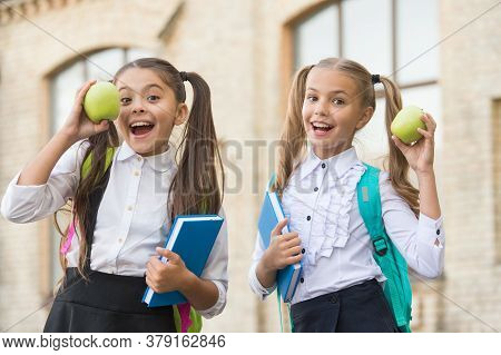 Students Girls Classmates With Backpacks Having School Lunch, Hungry Kids Concept.