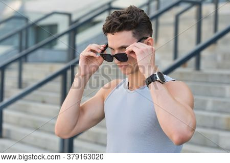 Stylish Sport Fashion.an Looking Over Sunglasses. Handsome Guy Wear Sport Clothes. Sportsman With Wa