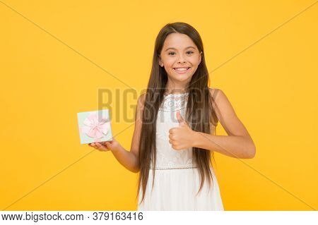 Perfect Package. Thank You. Child Happy Face Holds Big Gift Box Yellow Background. Kid Girl Delighte