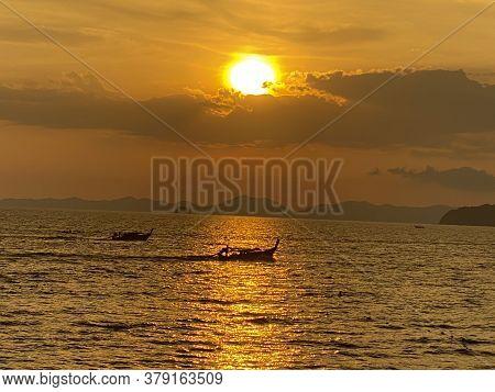 Sun Setting Over Ao Nang Beach In The Krabi Province Thailand