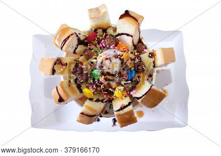 Top View Of Honey Toast With Vanilla Ice Cream And Chocolate Sauce