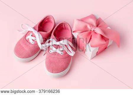 Pink Baby Shoes And Gift Present Box, Concept Of First Steps, Birthday, Baby Shower, Expectation, Pr