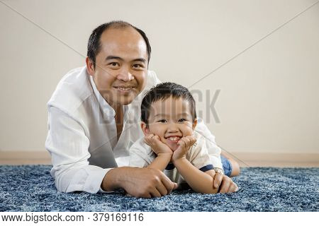 Asian Father And Son Smiling Portrait