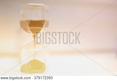 Sand Running Through The Hourglass Measuring The Passing Time In A Countdown To A Deadline, Hourglas