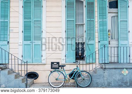 New Orleans, Louisiana/usa - 7/30/2020: This Image Is A French Quarter Home In Pastel Blue With Bicy