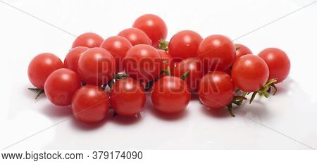 Bunch Of Fresh Organic Cherry Tomatoes On An Isolated White Background.