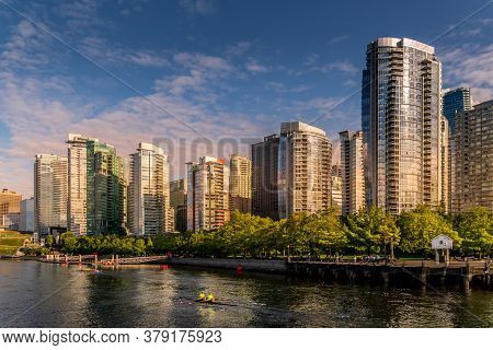 Vancouver, British Columbia/canada- July 11, 2019: Sunset Over The High Rise Buildings Along The Sho