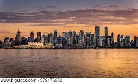 Vancouver, British Columbia/canada - July 11, 2019: Sunset Over The Skyline Of Downtown Vancouver. V