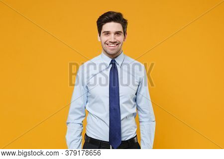 Smiling Handsome Young Business Man In Classic Blue Shirt Tie Posing Isolated On Yellow Wall Backgro