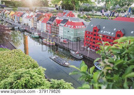 Billund, Denmark, July 2018: People Walk In Legoland In A Miniature City Made Of Constructor