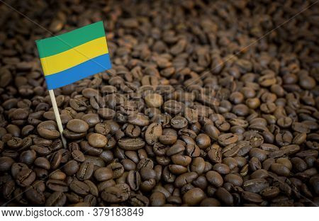 Gabon Flag Sticking In Roasted Coffee Beans. The Concept Of Export And Import Of Coffee