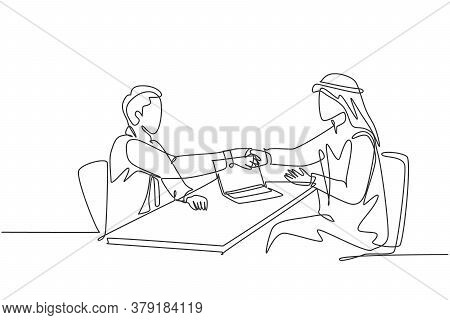One Continuous Line Drawing Of Young Muslim Business Man Handshake After Deal A Project. Saudi Arabi
