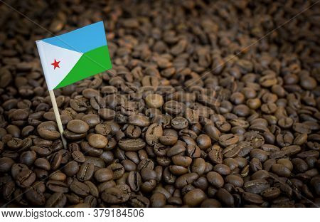 Djibouti Flag Sticking In Roasted Coffee Beans. The Concept Of Export And Import Of Coffee