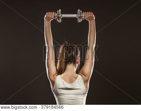 Strong Woman Lifting Dumbbells Weights. Fit Girl Exercising Gaining Building Muscles. Fitness And Bo